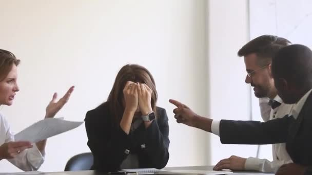 Angry colleagues shouting criticizing stressed sad female employee at meeting