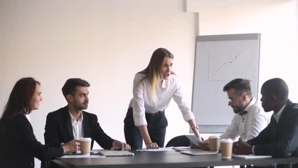 Angry female boss shouting at meeting firing stressed african employee