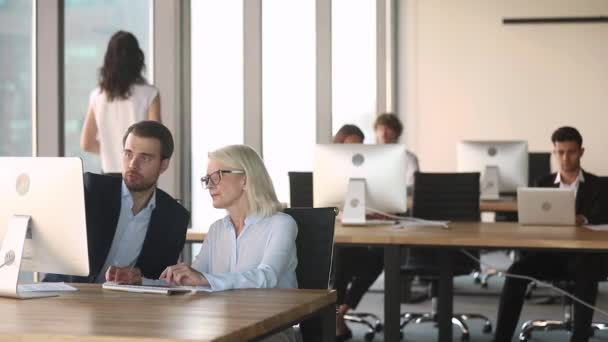 Company executives talking collaborating working on computer in modern office