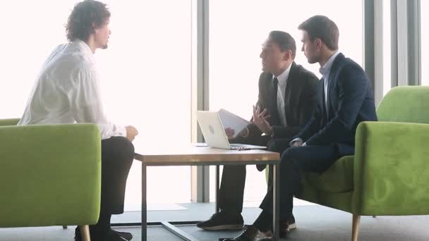 Male applicant and hr team employers disputing at job interview