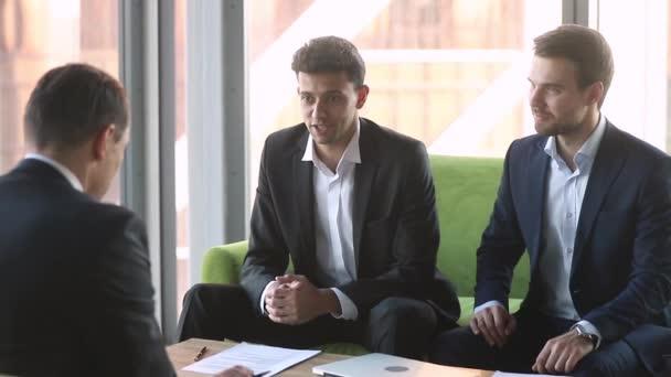 Arabic businessman handshake caucasian partner sing international partnership contract