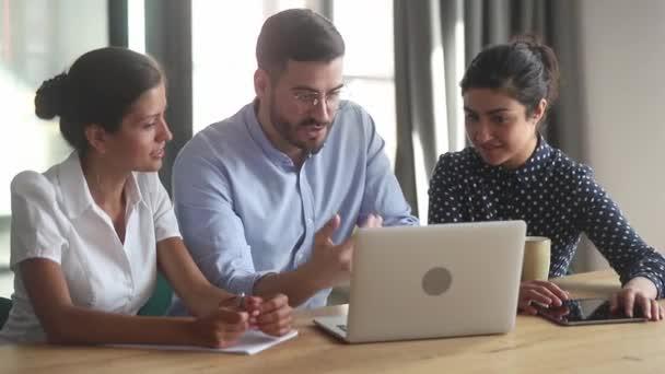 Helpful businessman mentor teacher coach teaching diverse female interns
