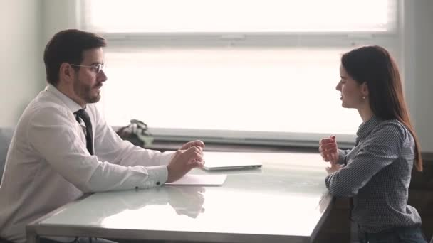 Focused hr manager interviewing young female job applicant