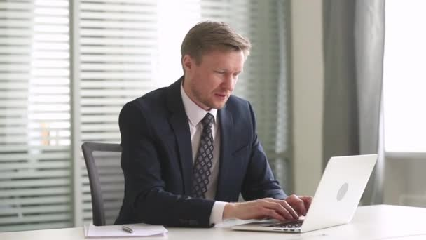 Happy businessman looking at laptop feel overjoyed reading great news