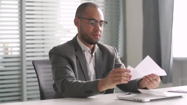 Happy african businessman read mail letter excited by good news