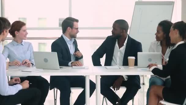 Companies representatives reach agreement leaders handshaking during business meeting