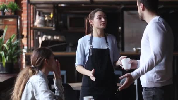 Dissatisfied couple restaurant clients complaining about cold coffee bad service