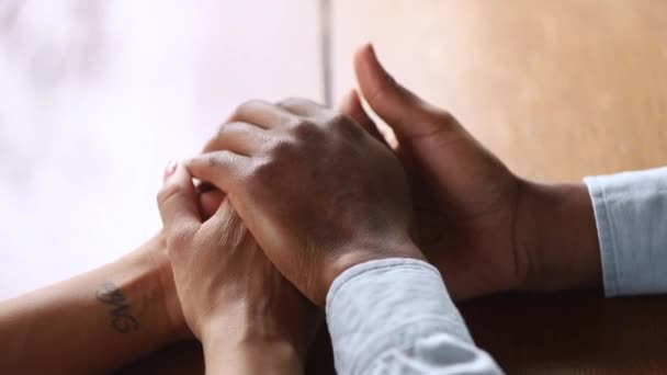 Close up view husband strokes arms of beloved wife