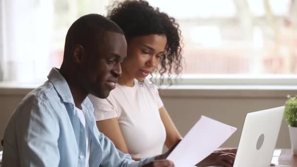 Husband dictates wife typing information filling internet application website form