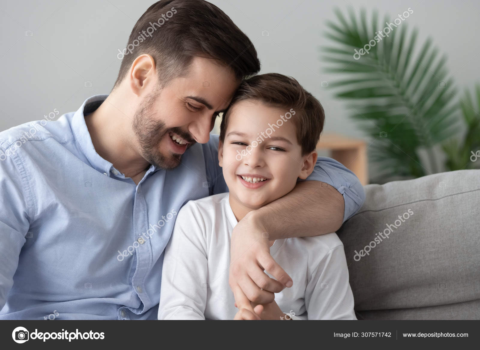 Affectionate Dad And Child Son Bonding Embracing Sit On Sofa Stock Photo C Fizkes 307571742