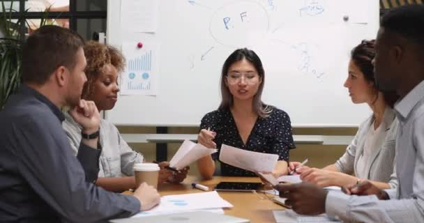 Female asian company leader discuss project plan with diverse team