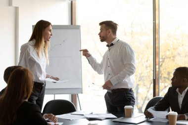 Angry male and female colleagues argue over paperwork at corporate team meeting, annoyed coworkers rivals man woman disputing about documents in office, gender rivalry, conflicts at work concept stock vector