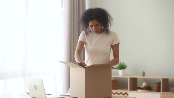 African client of postal delivery services opens box feels dissatisfied
