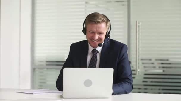 Businessman wearing headset having productive teleconference talking with corporate client