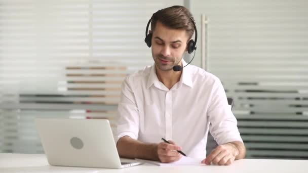 Businessman make videocall wearing headset talk with client or teacher