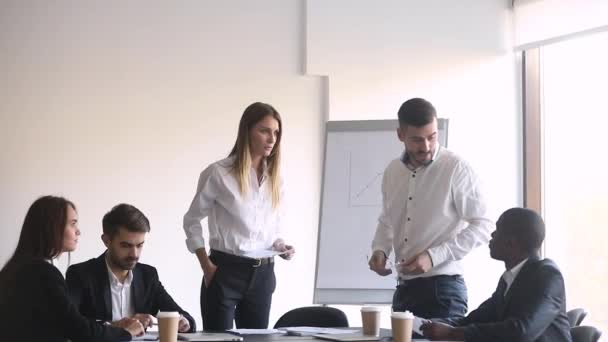 Male female colleagues having conflict arguing during meeting in boardroom