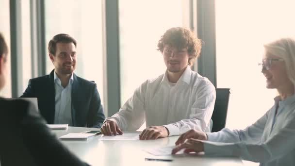 Businessman team leader offers ideas during briefing or negotiations