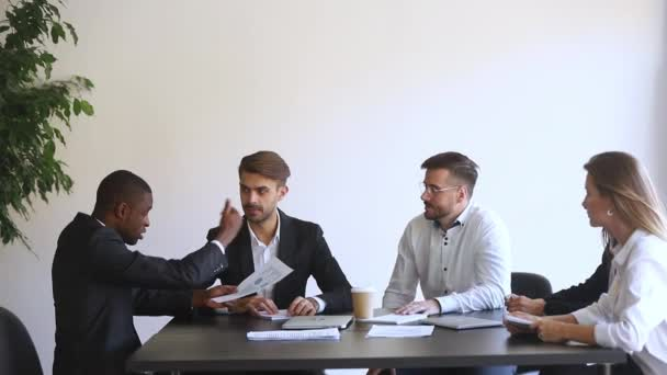 African and european businessmen conflict during business meeting in boardroom