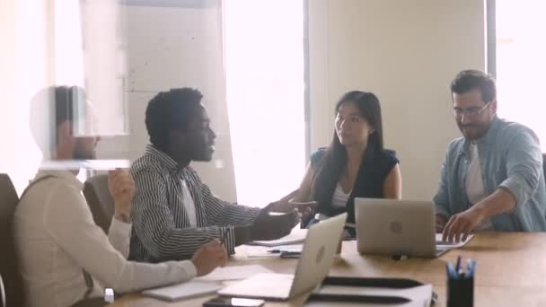 Diverse executive business team brainstorm on project at boardroom table