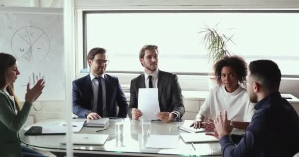 Successful diverse business people group having teamwork discussion in boardroom