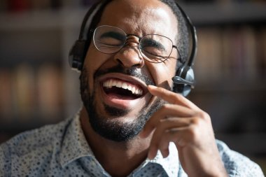 African guy singing song wearing headset closeup portrait