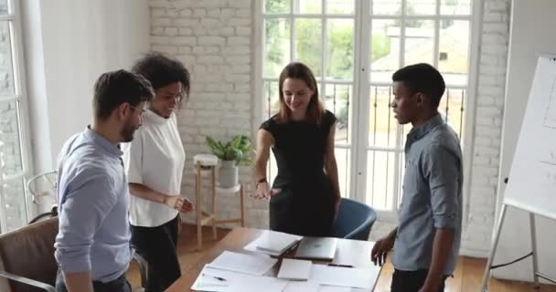 Happy diverse business team stack hands together as teamwork concept