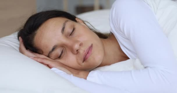 Calm healthy young woman serene face sleeping well in bed