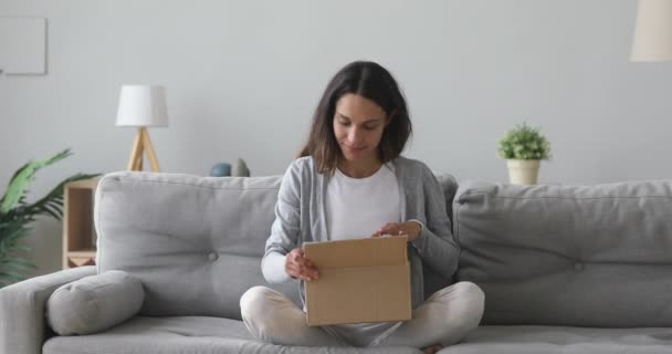 Happy young woman customer open carton box satisfied with parcel