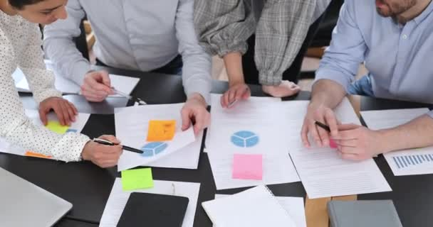 Business team people discussing chart analyzing paperwork at meeting