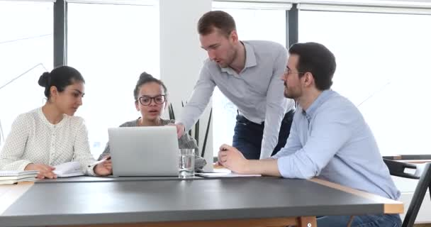 Team leader showing new corporate app to diverse company colleagues