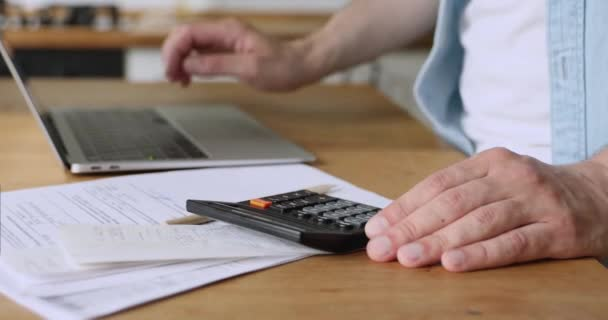 Man calculates personal incomes and expenses enters data use laptop