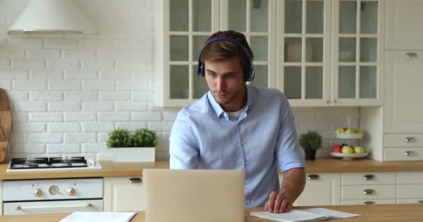 Confident businessman working remotely using video call app and laptop
