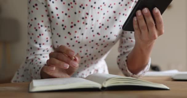 Closeup female holding cellular writing information taken on internet resources