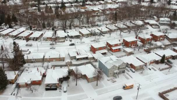 High level of snow storm, winter weather forecast alert day in the city. Top aerial view of people houses covered in snow, bird eye view suburb urban housing development. Quite neighbourhood.