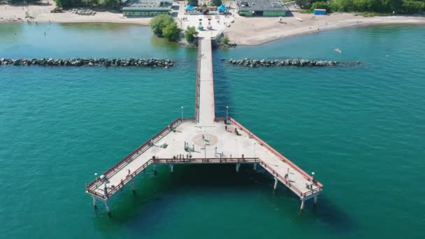 View of Toronto Centre Island Pier during summer. A lot of visitors. Aerial eye bird view.