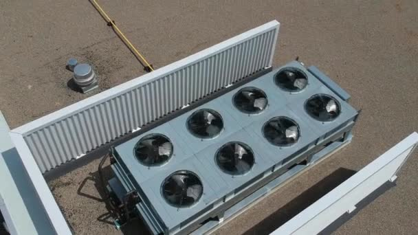 Aerial top view footage of AC exhaust vents of industrial air conditioning and ventilation at roof  at hot summer day.