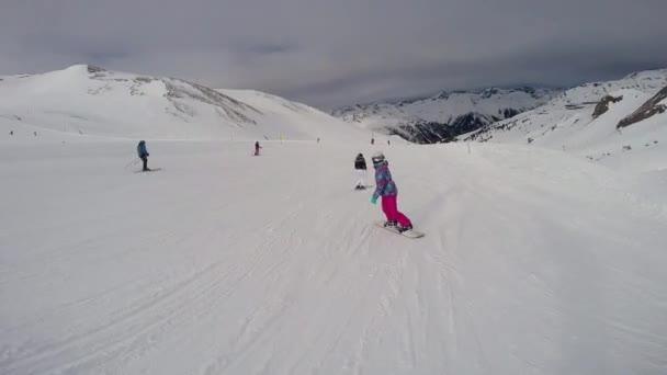 People ride ski and snowboard. Austrian Alps, Ischgl