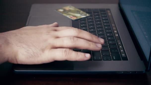 Man using credit card on-line