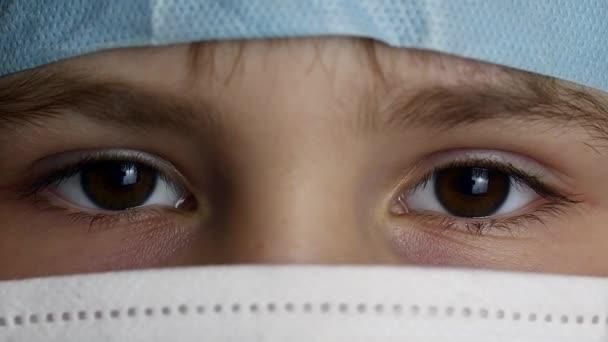 Closeup shot of boy eye in the doctor mask. shot in Ultra HD 4k