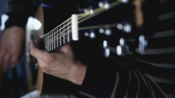 Guitarist musician playing on acoustic guitar. Guitarist plays music. Playing guitar music
