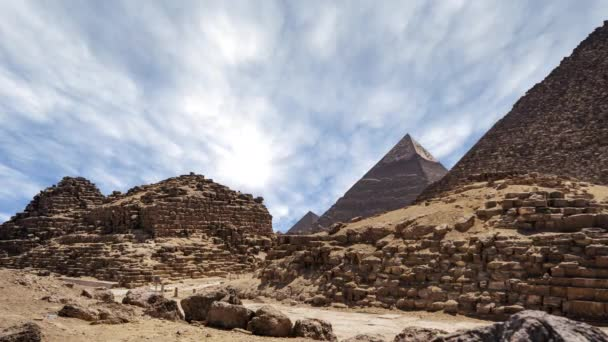 Time lapse with clouds over great pyramids at Giza Cairo in Egypt - Zoom In of Stone Pyramid
