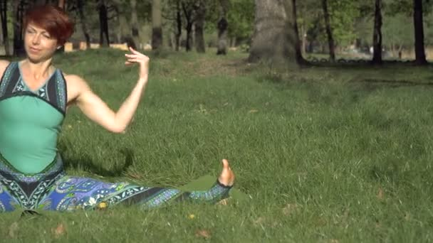 Yoga. The girl in the park is practicing yoga