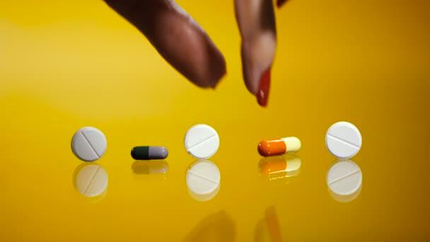 Pills. Hand takes a medical pill