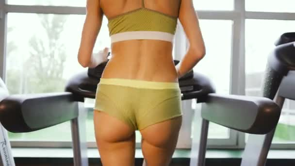 Treadmill. Girl runs on a treadmill in the gym