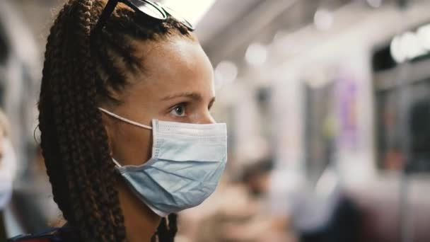 Medical mask. A woman in a medical mask rides on public transport.
