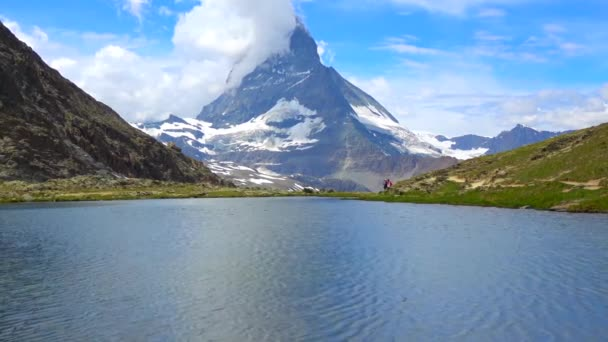 Flight over Matterhorn mountain in Switzerland Zermatt beautiful weather and clouds aerial footage