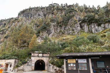 Berchtesgaden, Germany - October 3, 2019  - The Kehlsteinhaus (Eagle's Nest) located on top of Obersalzberg and the entrance of the tunnel to access it in Berchtesgaden, Bavaria, Germany stock vector