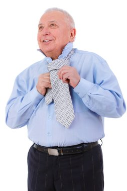 Happy and smile old mature businessman with white smile ties a tie. isolated on white background. Positive human emotion, facial expressio
