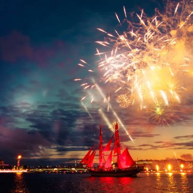 Miracle night show in St. Petersburg. Colorful fireworks and a ship with scarlet sails.
