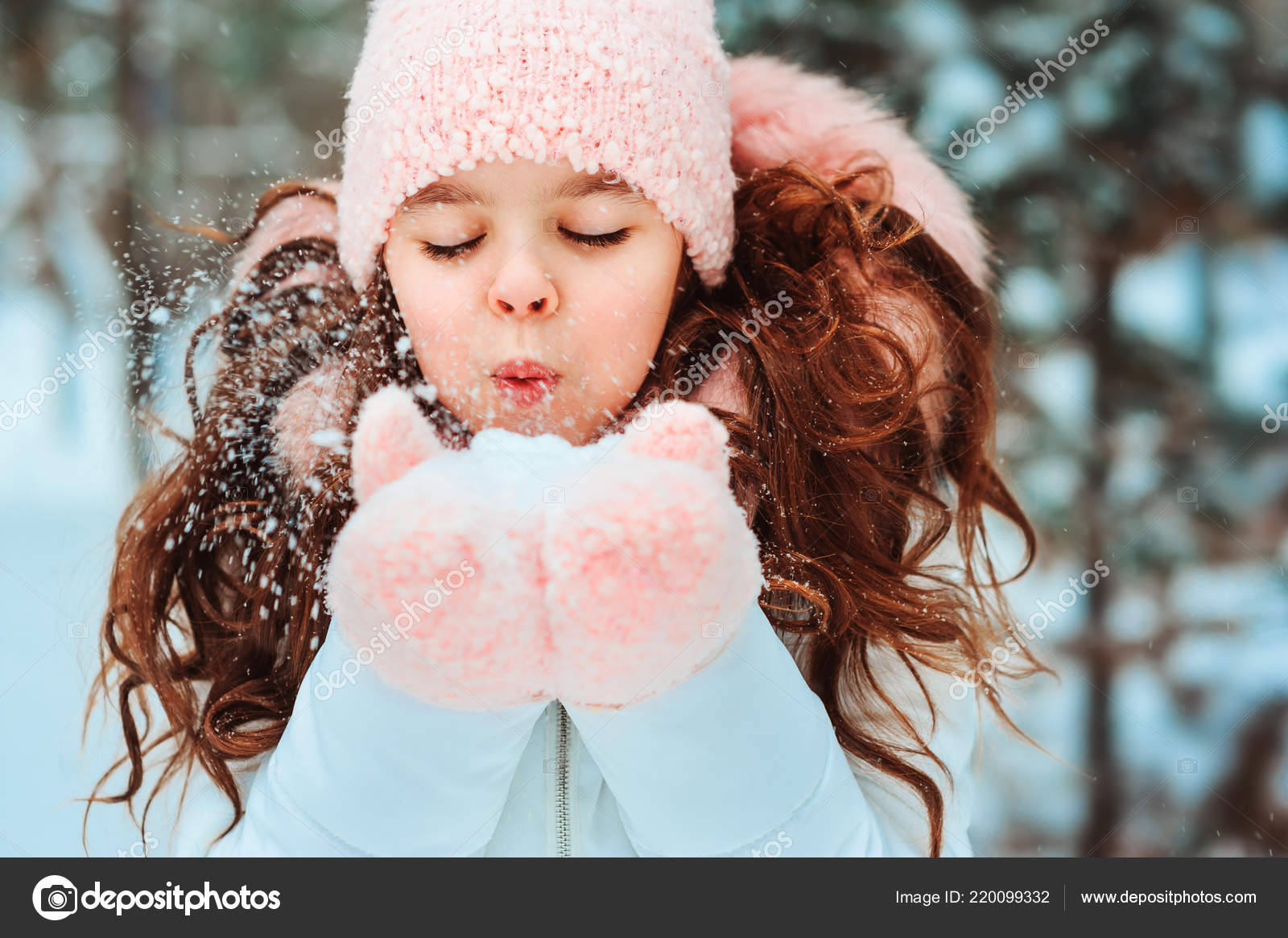 20dea2343ee6f Winter portrait of happy kid girl in white coat and hat and pink mittens  playing outdoor in snowy winter forest and blowing snow. Happy childhood  and active ...